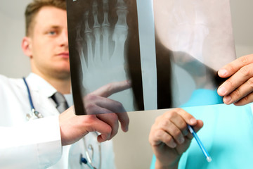 healthcare, medical and radiology concept -  Male doctors lookin