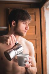Sleepy man pouring coffee