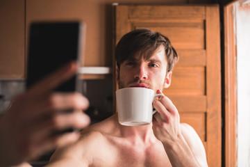 Self-shooting man with mug