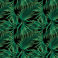 Seamless tropical floral pattern, green leaves on a black background.