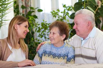 Elderly couple with happy caretaker