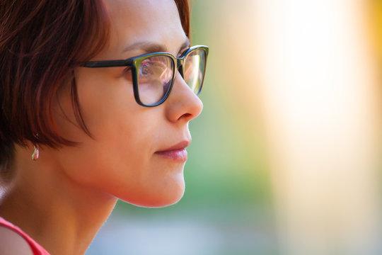 Portrait of a woman wearing glasses.