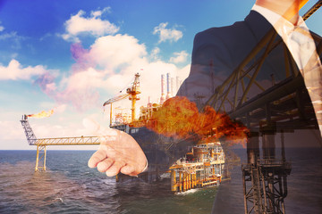 Investment in oil and gas industry with many money. The energy business in stock trader of offshore oil and rig industry. Engineering industry and investment with construction of the platform.