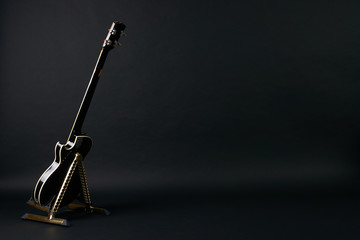 Bass guitar isolated on black background with copy space.Back view