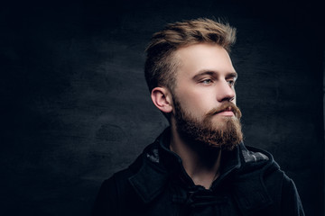 Portrait of bearded stylish young male.