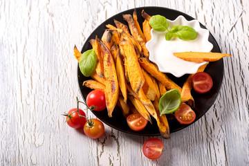 Healthy homemade sweet potato fries, vegetarian and vegan food