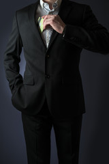 business man in suit holding in hand a credit card