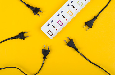 Messy of electrical cords and wires unconnected electrical power strip or extension block  with messy wires, top view on colorful background, messy electric equipment flat lay concept.