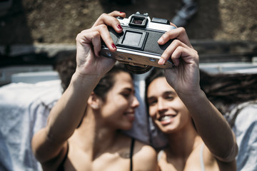 Close up of lesbian couple taking selfie in camera