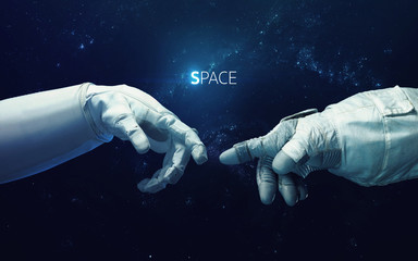 Wall Mural - Michelangelo God's touch. Close up of human hands touching with fingers in space. Elements of this image furnished by NASA