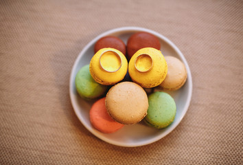 Two wedding rings on the colorful macaroons