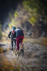 Two men riding bikes on a mountain road in Balcova - Izmir (Turkey)