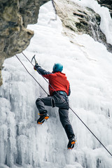 men climbed a frozen waterfall, icicle