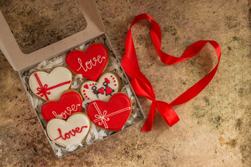 Valentine cookies in a box with red ribbon