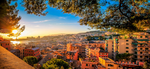 Genoa cityscape panorama during sunset.