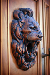 Wooden relief of lion