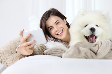 smiling woman with pet dog. selfie