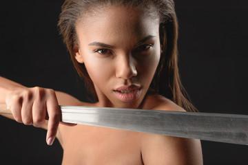 Angry mulatto girl threatening by machete