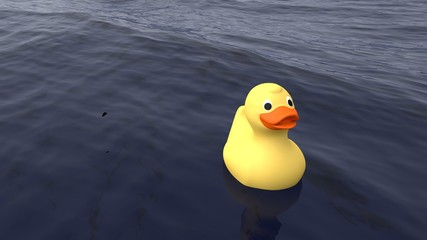 Lonely yellow rubber duck swimming on the ocean