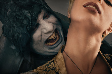 Ancient monster vampire demon bites a woman neck. Halloween fant