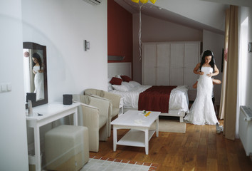 Preparation of the beautiful bride in the hotel room