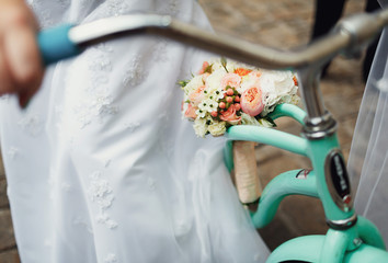 The bride riding by bicycle