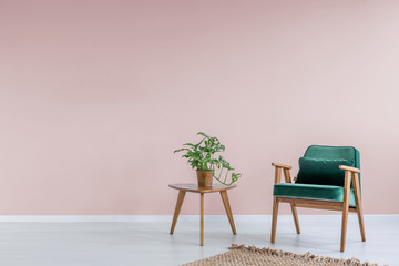 Pink room with green armchair Wall mural
