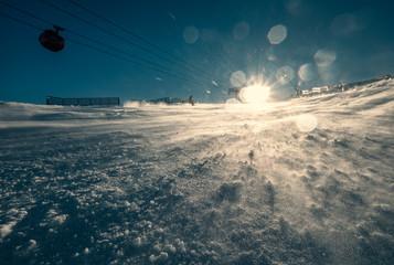 Ski resort snow hill in bright sunny light