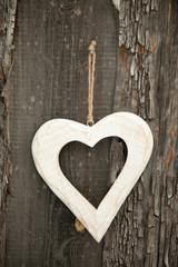 White heart on rustic wooden background