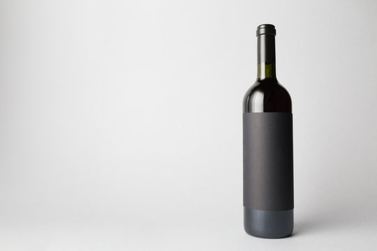 Wine Bottle is standing on gray background