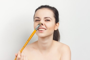 happy woman with big brush in hand