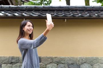 Woman take photo by mobile phone