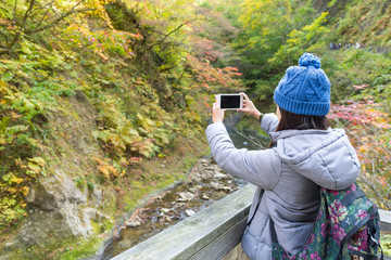Woman taking photo on mobile phone