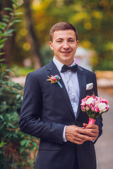 Young stylish man in a suit. Portrait of the groom.