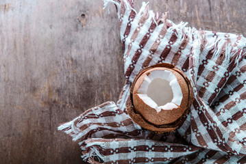 Coconut on a wooden table with a cloth
