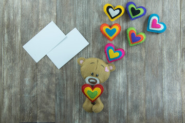Valentines Day postcard. Teddy Bear and colourful hearts