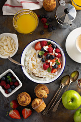 Breakfast table with rice pudding, fruit and muffins