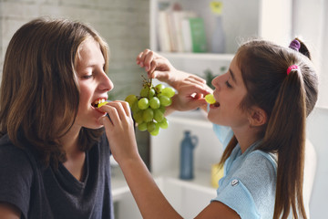 couple enjoys eating fresh grapes