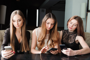 Young caucasian women using phone and saying no to life. Smartph
