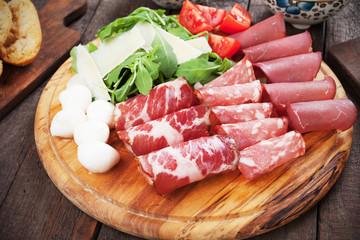 Charcutertie board with italian cured meat
