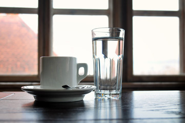 Closeup of a coffee cup and glass of water