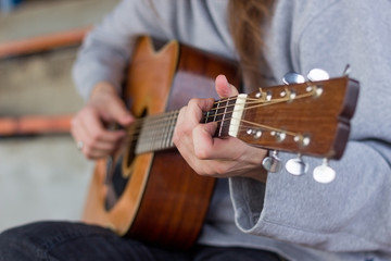 Creativity in focus. Close-up of men playing acoustic guitar.