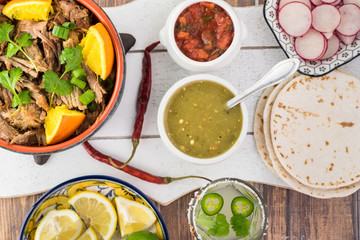 Mexican food. Slow cooked pork carnitas with salsa verde.