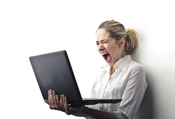 Girl going crazy in front of computer