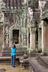 girl photographs ancient ruins