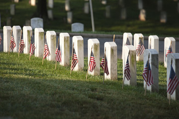 Grave markers with flags at Arlington National Cemetery on Memor