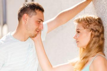 Man flirting with girl on city street