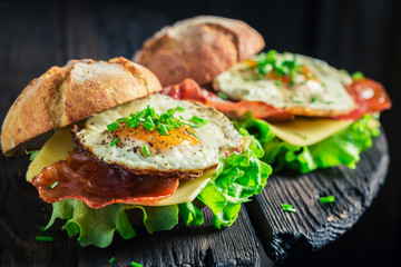 Fresh burger with eggs, cheese and bacon