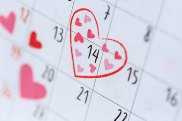 Date 14 in calendar with heart sign. Valentine day and love conc