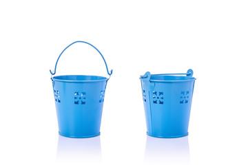Small blue vintage metal bucket. Studio shot isolated on white